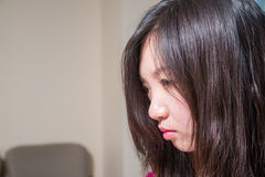 Depressed woman. Close portrait of young woman looking depressed Stock Images