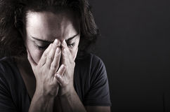 Depressed woman. Close up of depressed woman with hands in front of her face