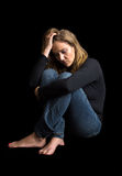 Depressed woman Stock Images