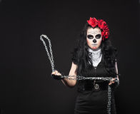 Depressed woman in day of the dead mask with chain Royalty Free Stock Images