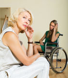 Depressed woman and disabled person Royalty Free Stock Photos