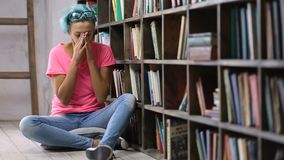 Depressed woman after failing exam in library stock footage