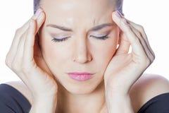Depressed woman. Feeling headache, holding her head royalty free stock photos