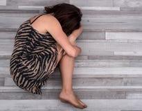 Depressed woman on the floor Stock Photos