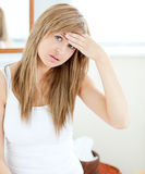 Depressed woman with a headache Stock Image