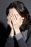 Depressed woman hiding face in her hands Royalty Free Stock Image