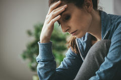 Depressed woman at home royalty free stock image