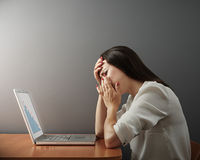 Depressed woman with laptop Royalty Free Stock Images