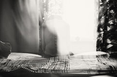 Depressed woman in light Royalty Free Stock Images