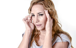 Depressed woman looking desperate in pain face expression suffering migraine and headache Stock Images