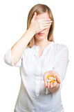 Depressed woman with pharmaceutical Stock Photography
