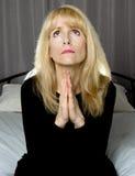 Depressed woman praying Royalty Free Stock Image
