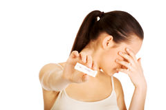 Depressed woman with pregnancy test. Unhappy sad woman with pregnancy test stock photos
