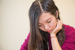 Depressed woman. Sad young woman looking depressed Stock Images