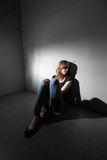 Depressed woman. Sitting on the floor (color toned image stock photography