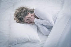 Depressed woman sleeping all day Royalty Free Stock Image