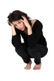 A depressed woman squatting Royalty Free Stock Images