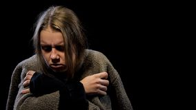 Depressed woman suffering drug withdrawal symptoms, miserable life, addiction. Stock photo stock images