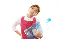 Depressed woman with a water bottle Royalty Free Stock Photo