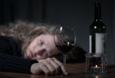Depressed woman with wine Royalty Free Stock Images