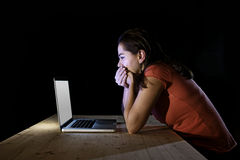 Depressed worker or student woman working with computer alone late night in stress Royalty Free Stock Photo