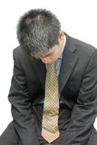 Depressed young Asian businessman Royalty Free Stock Photo