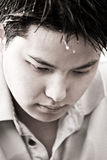 Depressed young asian male. A black and white shot of a depressed young asian male (shallow DOF, focus on the eyes Royalty Free Stock Photos