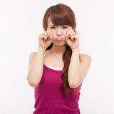Depressed young Asian woman. Isolated on white background Stock Images