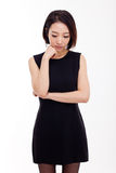 Depressed young Asian woman. Isolated on white background Stock Photo