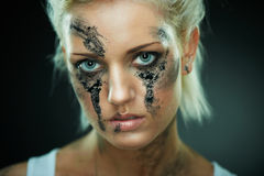 Depressed young beauty with dirty face Stock Photo