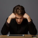 Depressed young business man Royalty Free Stock Photography