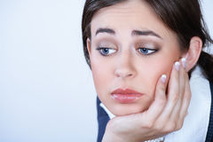 Depressed young business woman Royalty Free Stock Photo