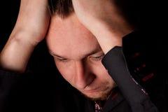 Depressed young businessman Stock Photos