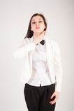 Depressed young businesswoman with sore throat Royalty Free Stock Images