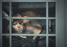 Depressed young couple standing close to each other Stock Photography