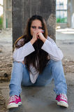Depressed young girl sitting in the abandoned building Stock Photo