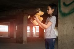 Depressed young girl standing alone in an abandoned building,Neglected,Children with Behavioral and Emotional Disorders. Depressed young asian girl standing stock photos