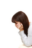 Depressed young Japanese woman royalty free stock photography