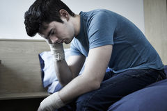 Depressed Young Man With Bandaged Wrists After Suicide Attempt Royalty Free Stock Photos