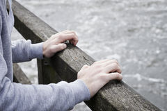 Depressed Young Man Contemplating Suicide On Bridge Over River Stock Images
