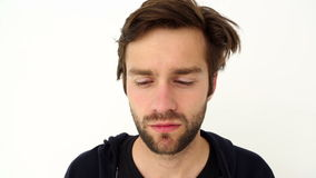 Depressed young man. On white background stock video