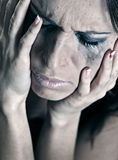 Depressed young woman. Closeup portrait of depressed young woman Royalty Free Stock Photography