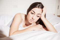 Insomnia depressed woman. Depressed Young woman with insomnia in bed cant sleep Royalty Free Stock Images