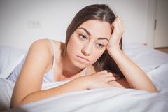 Insomnia depressed woman. Depressed Young woman with insomnia in bed cant sleep Royalty Free Stock Photography