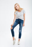 Depressed young woman showing ripped pants Stock Photos
