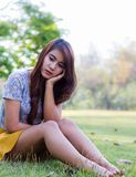 Depressed young woman sitting alone Royalty Free Stock Image