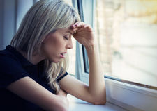 Depressed young woman Stock Photos