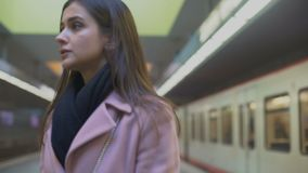 Depressed young woman suffering psychological problems sitting in subway station. Stock footage stock footage