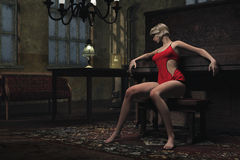 Depressed young woman in unkempt apartment. Young woman in red negligee sits leaning against piano in old fashioned apartment Stock Photography