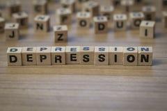 Depressie in houten kubussen wordt geschreven die Stock Afbeeldingen